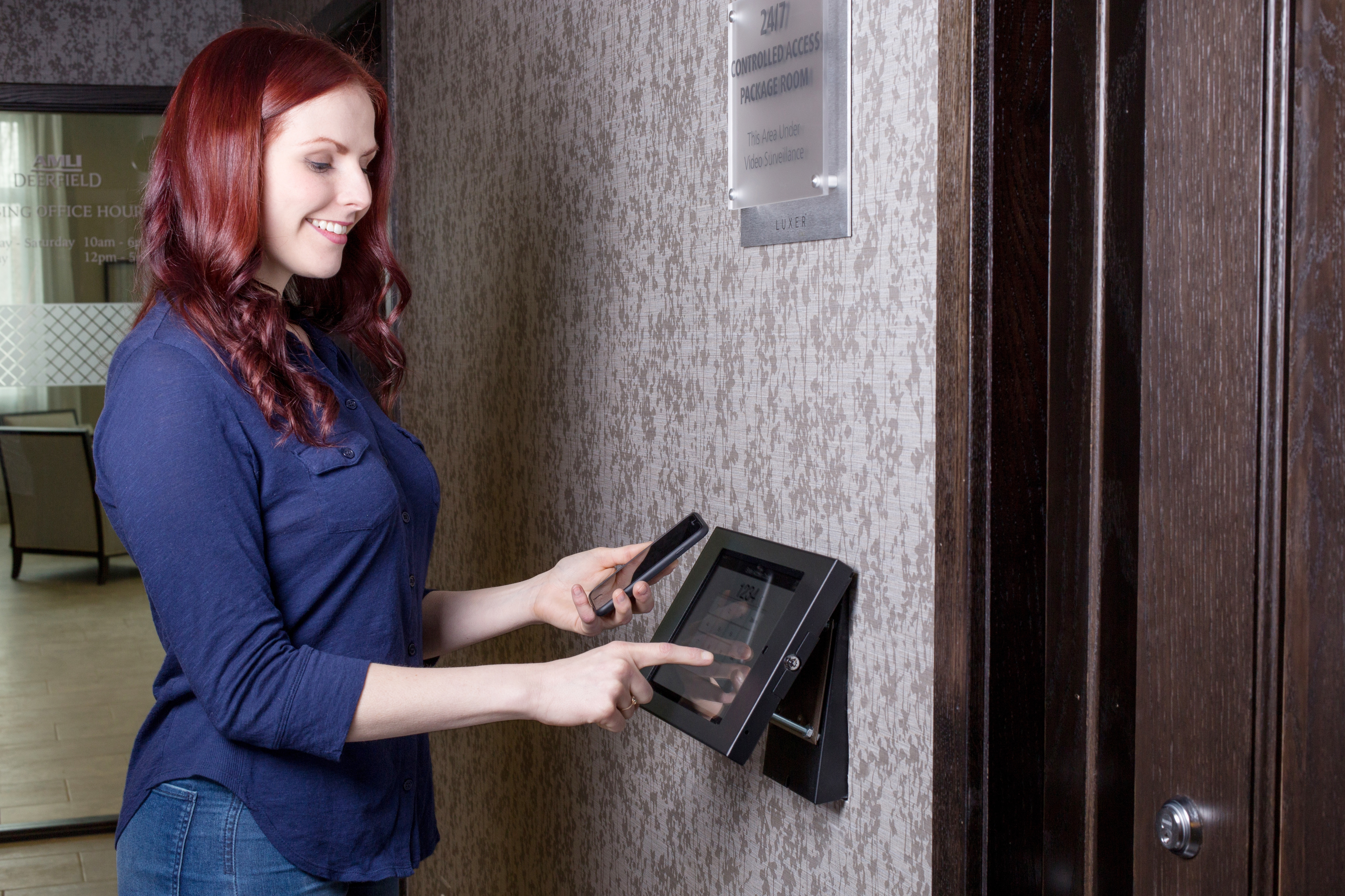 A resident uses the Luxer One Touchscreen to access the Luxer Room.