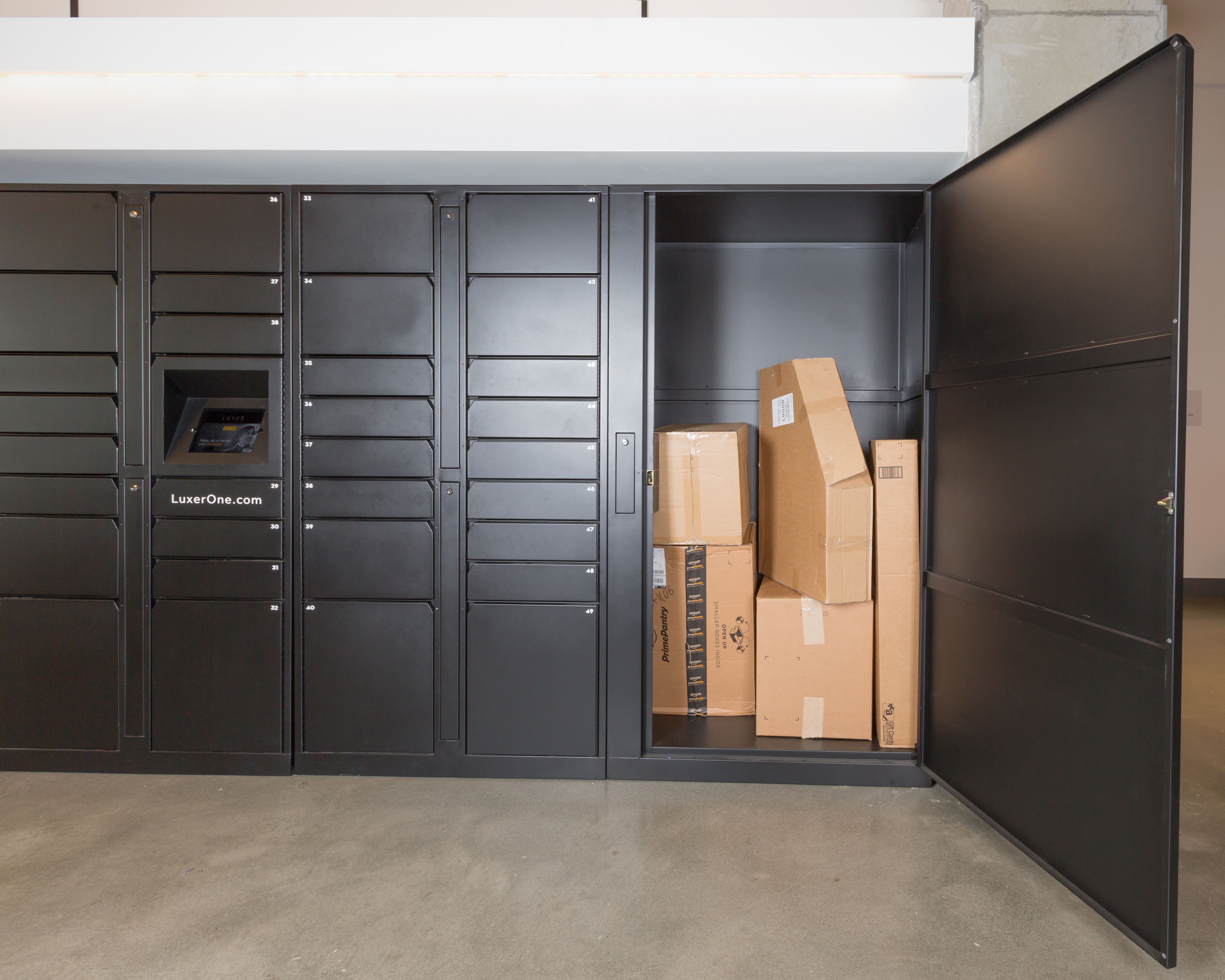 Five extra-large packages inside an open Luxer Oversized Locker.