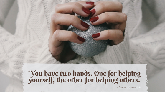 "Close-up of a woman's hands holding a silver sphere, with the Sam Levenson quote: ""You have two hands. One for helping yourself, one for helping others."""
